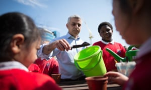 Sadiq Khan with pupils on a visit to Sir John Cass's Foundation primary school in London