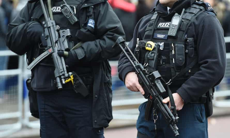 Armed police officers.