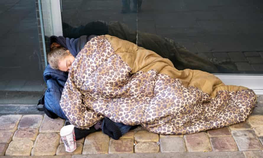 A homeless woman sleeps rough in Manchester