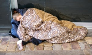 Homeless woman sleeping rough