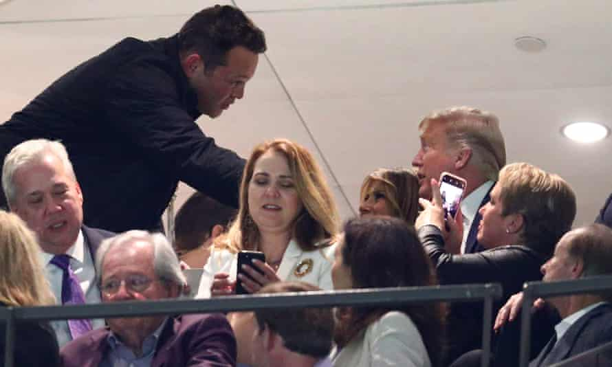 Actor Vince Vaughn greets Donald Trump and Melania Trump at a football game in New Orleans on Monday night.