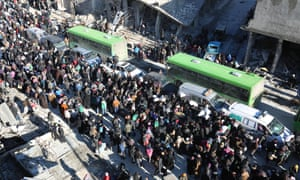 Civilians are evacuated by bus from Aleppo this week.