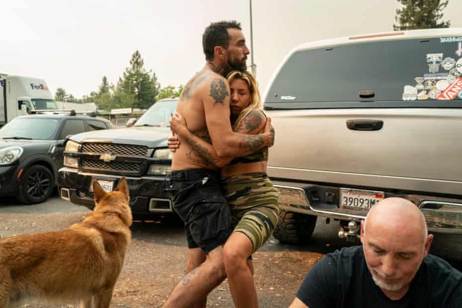 Whitney Millstone hugs her partner, Wes Colunga.