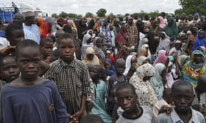 People displaced by Boko Haram take refuge at a school in the regional capital, Maiduguri.