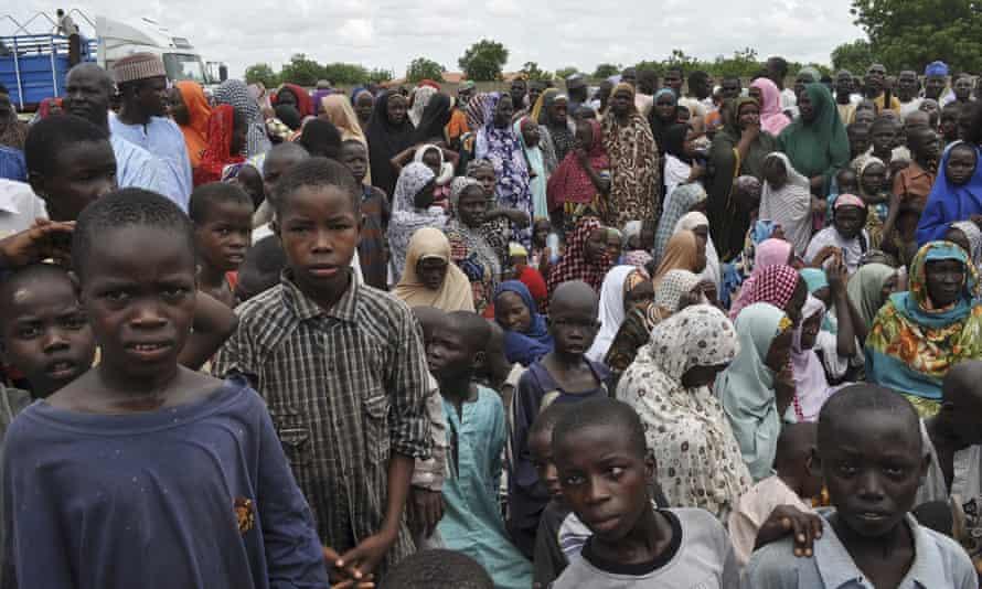 People displaced by Boko Haram take refuge at a school in the regional capital, Maiduguri.