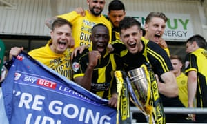 Burton Albion lift the runners-up trophy after securing promotion to the Championship with a 0-0 draw against Doncaster at the Keepmoat Stadium.