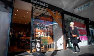 A shopper makes her way into a store offering a closing down sale in Auckland