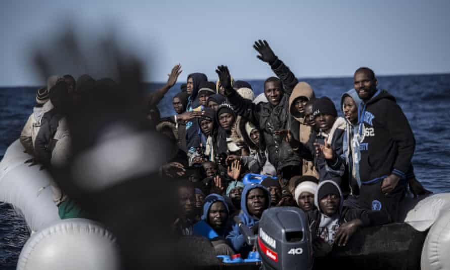 Migrants are rescued from a boat by members of an NGO in the Mediterranean, about 20km north of Ra's Tajura, Libya, last week.