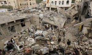 People at the site of a Saudi-led airstrike in Yemen's capital Sana'a.