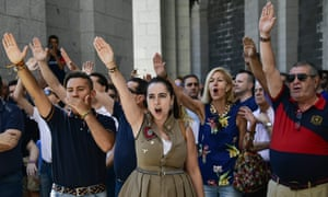 People make the fascist salute at the Valley of Fallen in 2018.