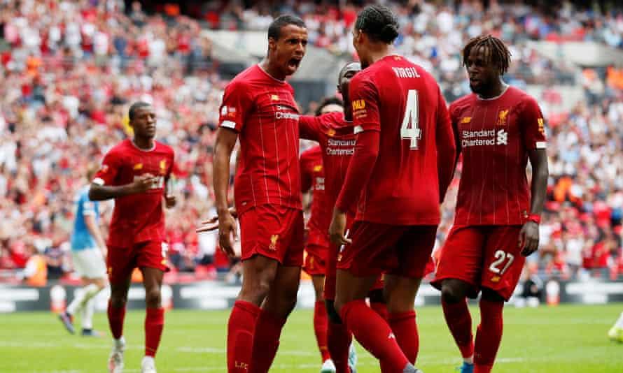 Joël Matip (left) and Virgil van Dijk celebrate after the Liverpool centre-backs combined for their side's equaliser at Wembley.