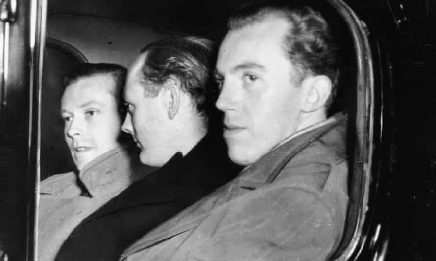 From left, Michael Pitt Rivers, Lord Montagu of Beaulieu and Peter Wildeblood leave court after being found guilty of gross indecency, London, 1954.