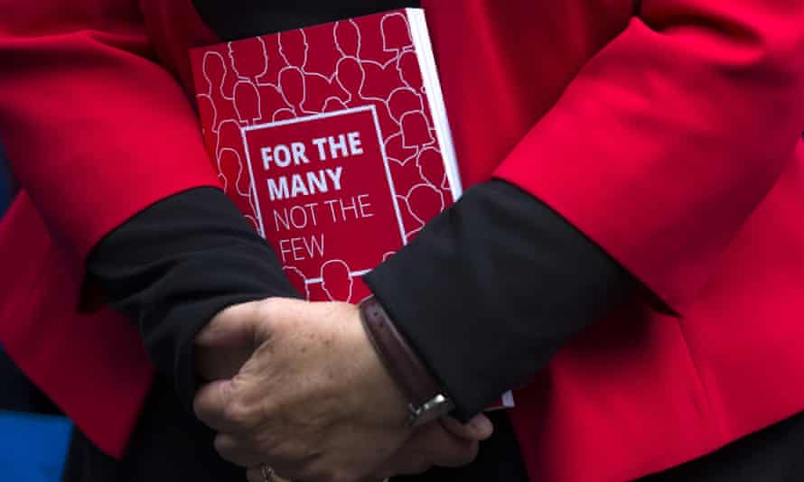 A supporter holds a Labour party manifesto, May 2017.