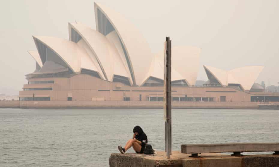 The Sydney Opera House seen through thick smoke from the Australian bushfires