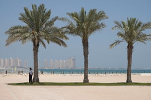 A security guards stands in the shade at a five-star hotel in Doha