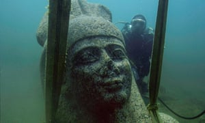The head of a colossal red granite statue of the god Hapi that decorated the temple of Thonis-Heracleion, is lifted from the sea bed.