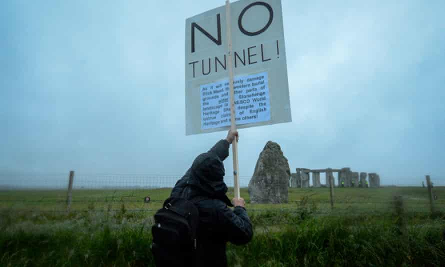 A protester holding a placard opposing the building of a tunnel at Stonehenge earlier this year.