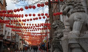 People walk through Chinatown on 12 February n London. This year's festivities, which usher in the Year of the Ox, take place while the UK remains in lockdown