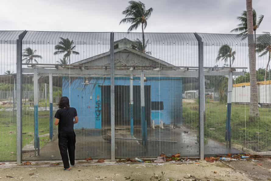 Behrouz Boochani stands outside the naval base where he and the other refugees were locked in the first three years.