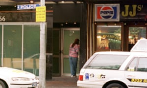 Sydney, May 7, 2001. An unidentified woman speaks on the intercom before entering the heroin injecting centre at King's Cross today. Eight people made use of Australia's first heroin injecting room when it started operations last night. (AAP Image/Laura Friezer) NO ARCHIVING