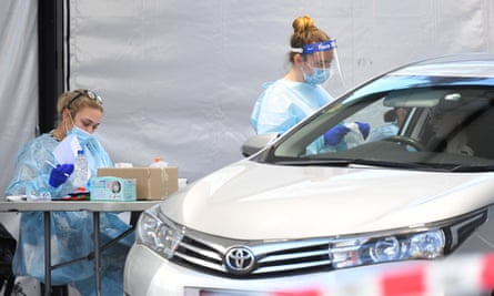 Healthcare workers carry out swab tests at a makeshift drive-through Covid-19 testing facility in Keilor, Melbourne, on Wednesday. Twelve new testing sites will be established across the 36 hotspot suburbs as Victoria imposes new localised lockdowns.