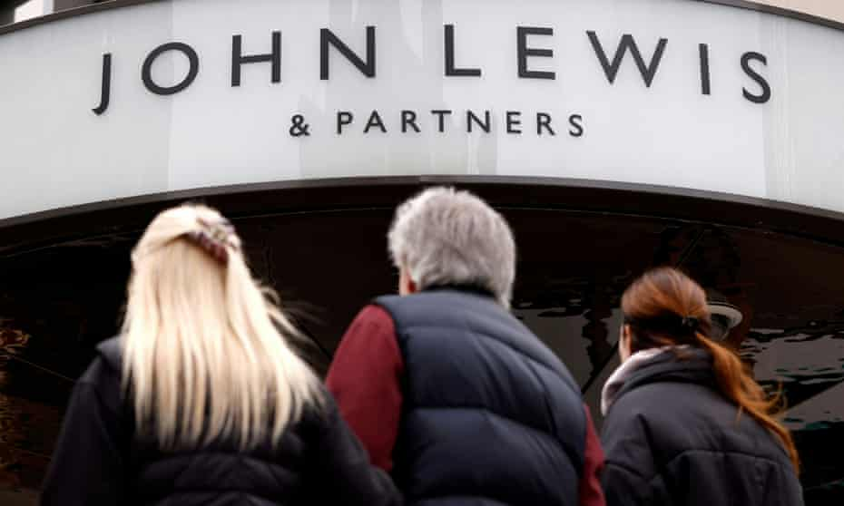 People outside a John Lewis department store on Oxford Street