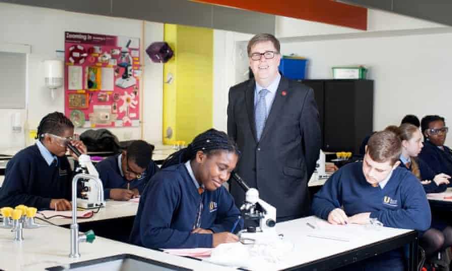 Headteacher Richard Brown with pupils at the Urswick school, Hackney, London.