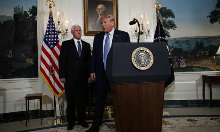 Vice-President Mike Pence looks on as Donald Trump walks off after speaking about the mass shootings in El Paso, Texas, and Dayton, Ohio, at the White House on Monday.