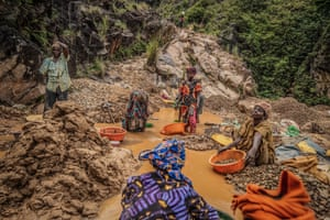 Woman pan for gold at a mine in the eastern Congolese town of Kamituga