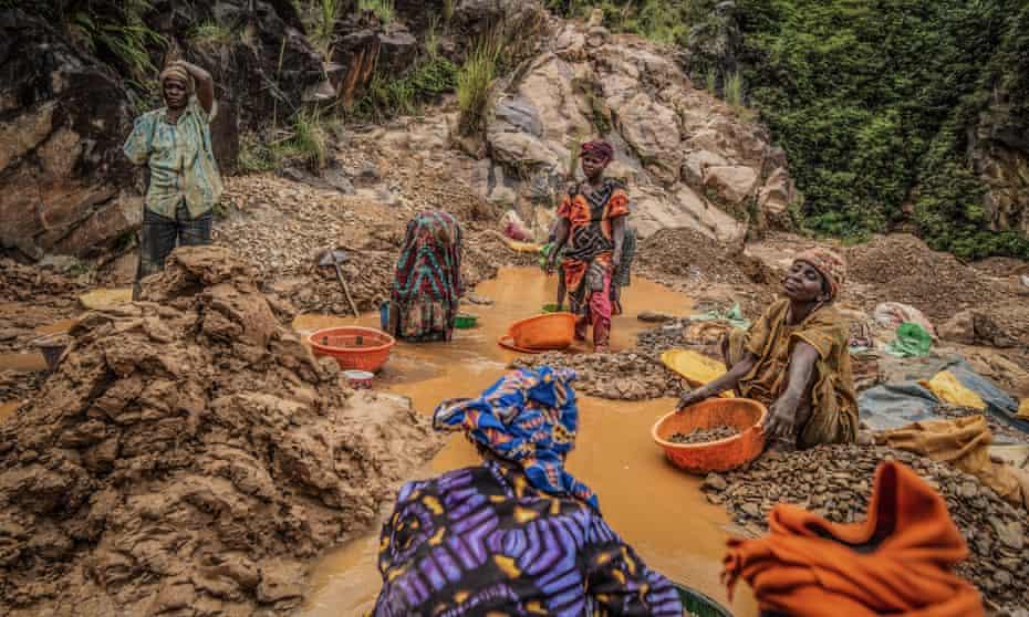 Women pan for gold in Kamituga, in eastern Congo's South Kivu province