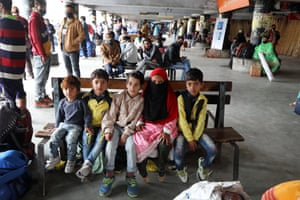 Jammu, India: stranded passengers wait at the bus station