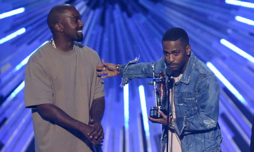 """Kanye West and Big Sean an award"""" at the MTV Video Music Awards in 2015."""
