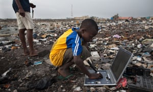 A boy sifts through electronic waste in Agbogbloshie dump in the Ghanaian capital Accra.
