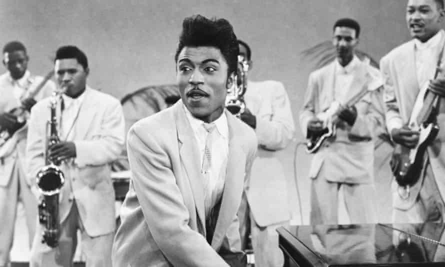 Little Richard onstage with his band in a scene from the 1957 film Mister Rock and Roll.