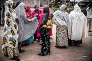 Women gather after polls close in the presidential elections, Yola, Nigeria