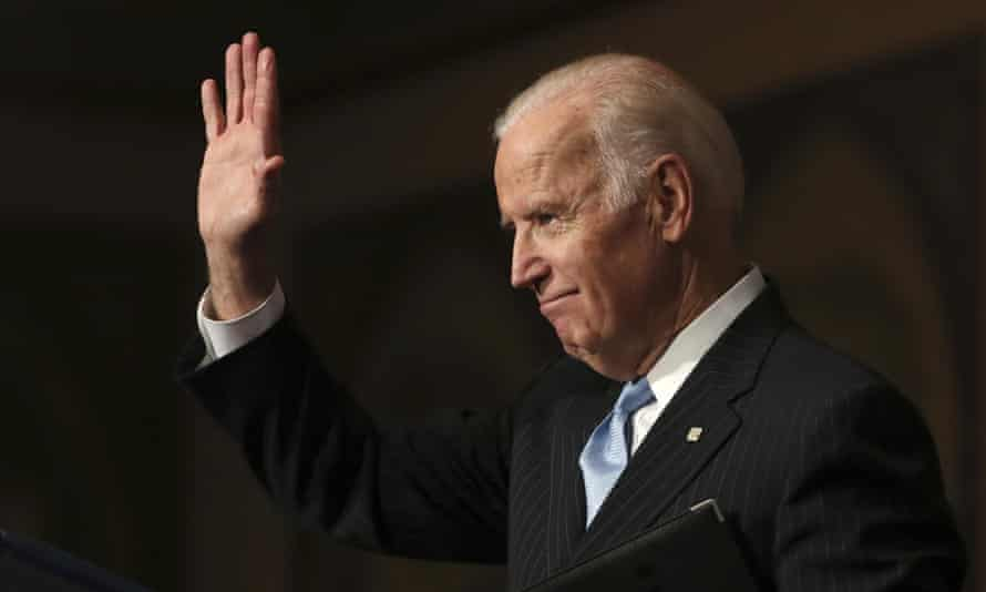Joe Biden, the the vice-president, waves as he concludes his speech about sound financial sector regulation at Georgetown University in Washington on 5 December 2016.