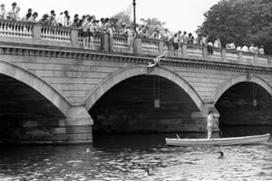 As the temperature reached the eighties, people cooled off by diving off a bridge in to the Serpentine