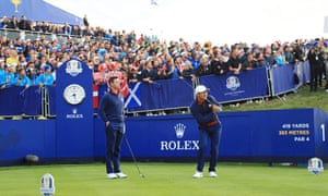 Rory McIlroy watches on as Thorbjorn Olesen of Europe plays his shot from the first tee at the Ryder Cup.