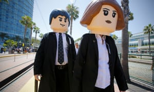 A husband and wife dressed as life-size Lego versions of agents Mulder and Scully from the X-Files