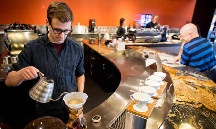 Barista Henri Thomas works the slow bar at Steamdot in Anchorage.