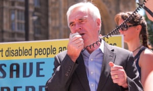 John McDonnell addresses a Disabled People Against Cuts rally outside parliament in June