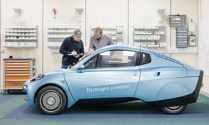 Workers inspecting the Rasa hydrogen-powered car at Riversimple, LLandrindod Wells, Wales.