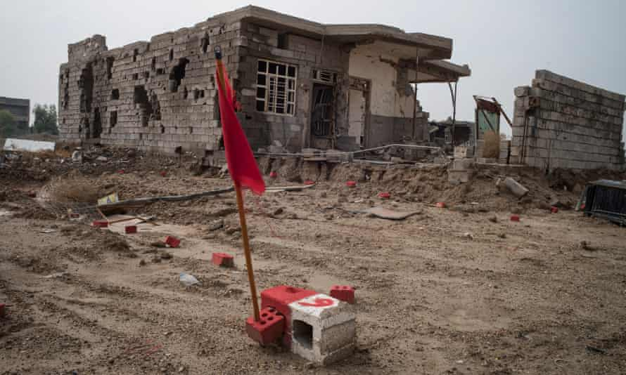 Red bricks mark areas yet to be swept for explosive devices