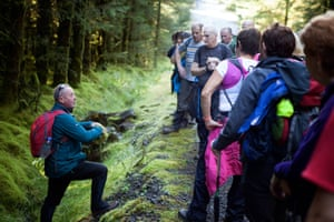 Walkers listening to a guide at the Serrins & Killeter Walking Festival