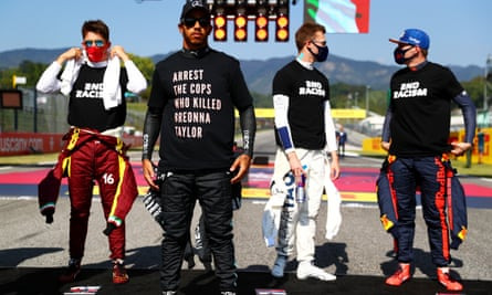 Lewis Hamilton wears a t-shirt displaying the message 'arrest the cops who killed Breonna Taylor' at the Tuscan Grand Prix.