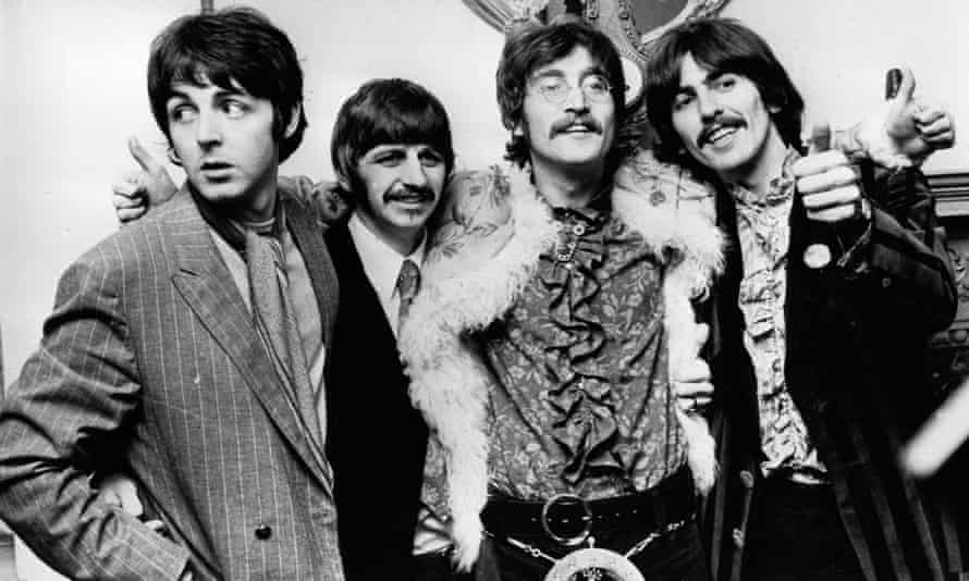 The Beatles celebrating the completion of Sgt Pepper's Lonely Hearts Club Band in 1967.