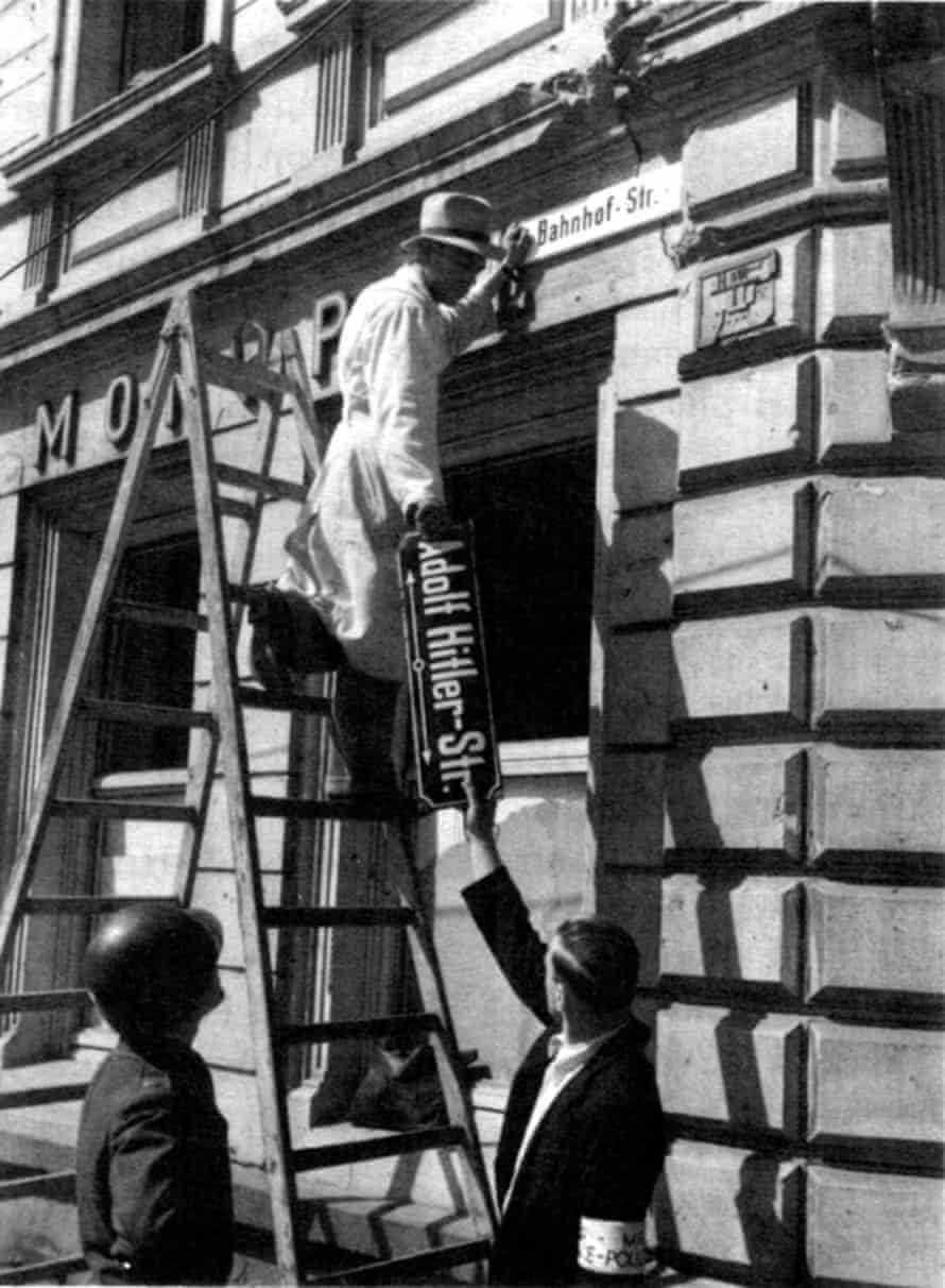 A Nazi-era street sign is removed in Trier, Germany, days after the end of the second world war