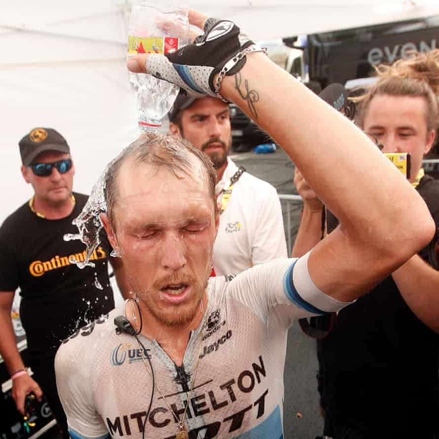 Matteo Trentin of Mitchelton Scott team cools off after winning the 17th stage.