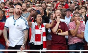 Frustrated Arsenal supporters react to a VAR decision ruling out a potential winning goal against Tottenham at the Emirates Stadium in September.
