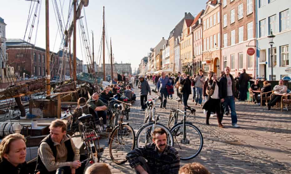 The waterfront promenade of Nyhavn Canal, Copenhagen, Denmark.